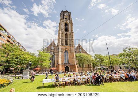 ROTTERDAM, NETHERLANDS - August 06, 2017: People having a breakfast in front of the famous saint Laurens church in Rotterdam city