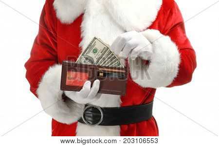 Santa Claus holding purse with money on white background