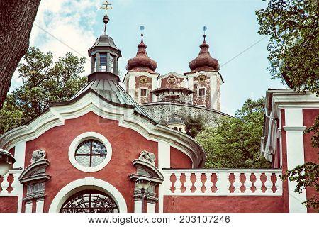 Calvary in old mining town Banska Stiavnica Slovak republic. Religious architecture. Travel destination. Old photo filter.