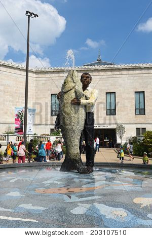 CHICAGO, ILLINOIS - SEPTEMBER 5, 2016: Man with Fish. The 16 foot tall bronze piece by German sculptor Stephan Balkenho was installed in 2001.
