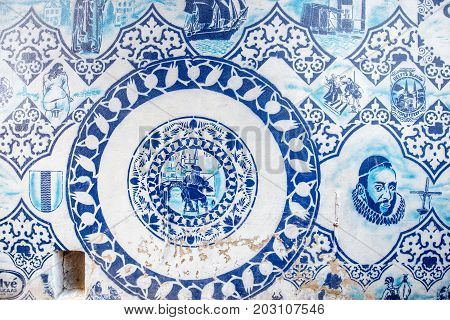 DELFT, NETHERLANDS - August 07, 2017: Wall with traditional dutch blue paintings in the centre of Delft town in Netherlands