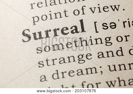 Fake Dictionary Dictionary definition of the word surreal. including key descriptive words.