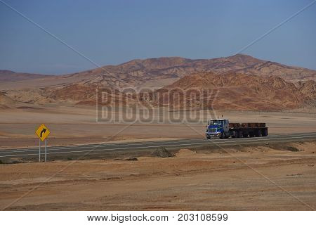 Atacama Desert, Chile - August 18, 2017: Truck carrying copper plates on the Pan American Highway running through the harsh and arid landscape of the Atacama in northern Chile.