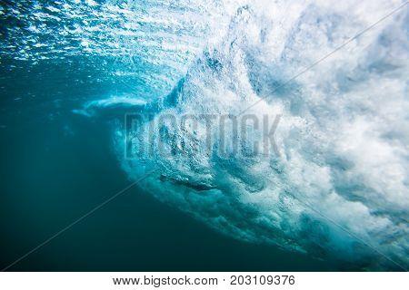 Wave underwater. Blue tropical ocean in underwater