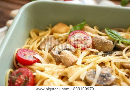 Delicious roasted turkey tetrazzini in baking dish, close up