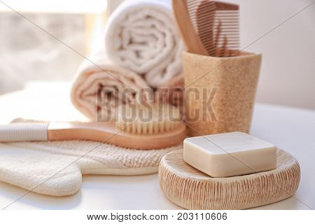 Composition with soap and bath accessories on table
