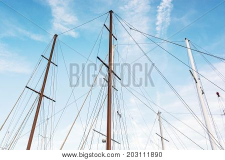 Masts of sailboat and blue sky. Summer vacation. Transport theme.