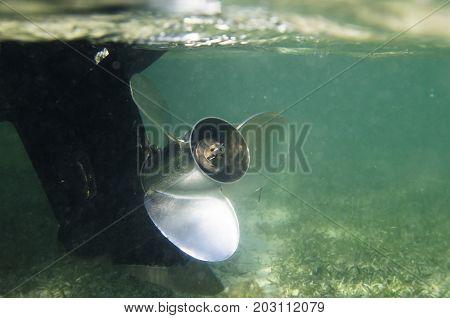 Rowing propeller of a motor boat under water