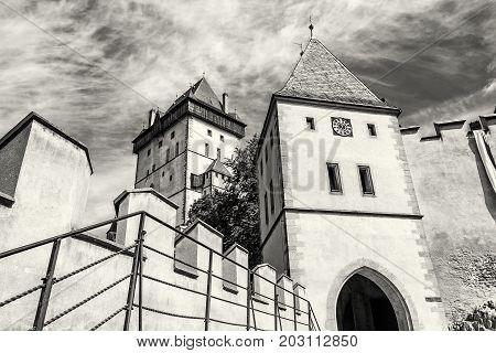 Gothic castle Karlstejn in Czech republic. Ancient architecture. Travel destination. Black and white photo.