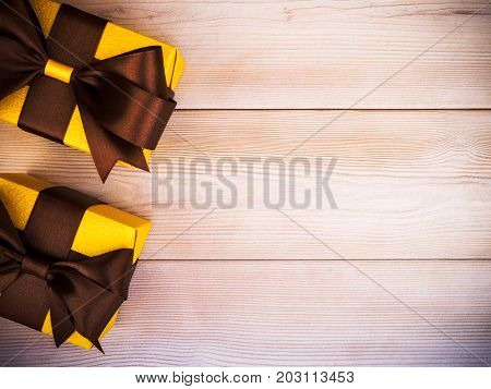 Composition of packed present boxes on wooden board. Celebrations concept