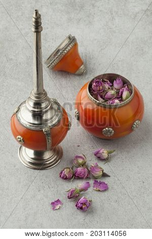 Dried rose buds in a Moroccan bowl for use to sprinkle rose water