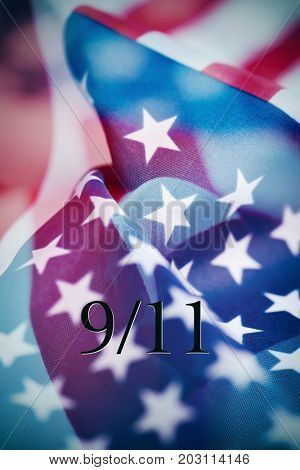 multiple exposures of different pictures of the flag of the United States of America, and the text 9/11 for the September 11 attacks