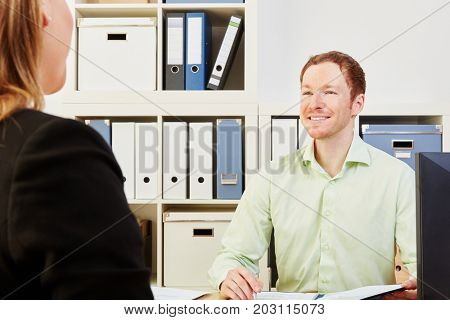 Woman looking for a job during an interview in a company