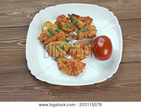 Buffalo Popcorn Chicken,  close up baked meal