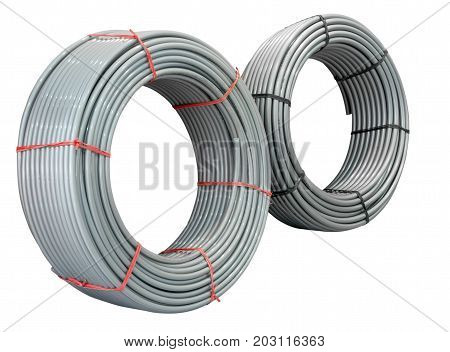 Plastic water pipes rolled into a ring. Two coils. Isolated on white background.