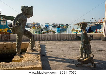 Bronze Statue Representing A Fisherman And A Boy