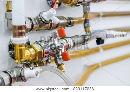 System of plastic pipelines and regulators. Steel curved tubes, brass connectors and valves.