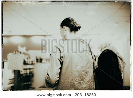 Vintage Black And White Photo Of Woman Standing In Line At The Checkout