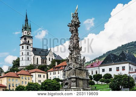 Saint Catherine's church and Plague column in Kremnica city Slovak republic. Architectural theme. Travel destination.