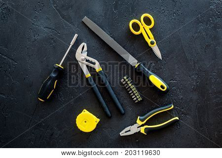 constructor desk with set of building implements on dark desk background top view