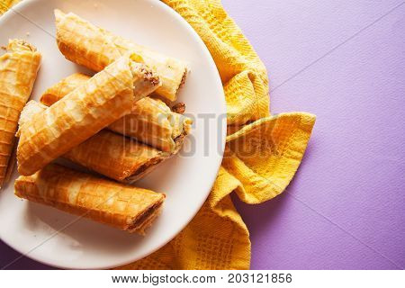 sweet rolled viennese waffles on white plate