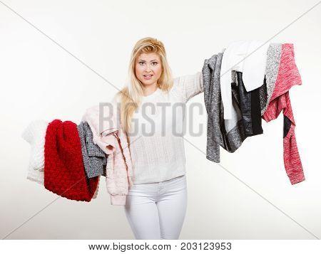 Woman Holding Many Clothing