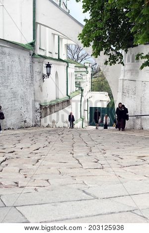 KIEV, UKRAINE - MAY 3, 2011: This is a cobbled road from the upper part of the monastery to the lower one.