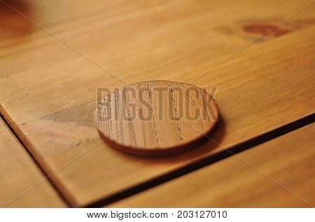 Traditional Wooden Coaster vintage style for beer on table