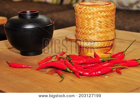 Asian pot made of sisal with red chilli peppers