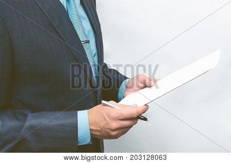 Business man reading text of agreement documents. Contract or agreement conclusion.