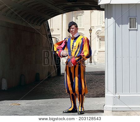 VATICAN CITY VATICAN - MAY 17, 2012: Famous Swiss Guard guarding the entrance to the Vatican City