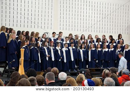 JOLIET, ILLINOIS / UNITED STATES - DECEMBER 3, 2015: Tim Placher conducts the Eighth Grade Choir at the Drauden Point Middle School Winter Choir Concert