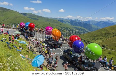 Col de PeyresourdeFrance- July 23 2014: Fancy vehicle of Senseo vehicles passing in the Publicity Caravn on the road to Col de Peyresourde in Pyrenees Mountains during the stage 17 of Le Tour de France 2014.
