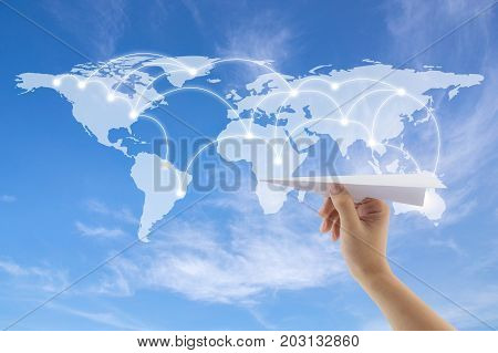 plane in hand with world map on background Map of flight routes airplanes network use for global travel importexportlogistics network concept Elements of this image furnished by NASA