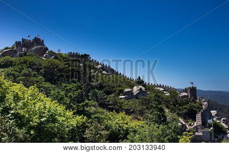 The hill with Arabian moorish castle on the top. Summer picture with blue sky. Sintra Portugal.