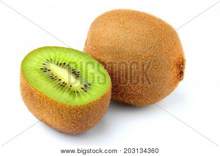 Fresh ripe kiwi fruit cut in half isolated on a white background.