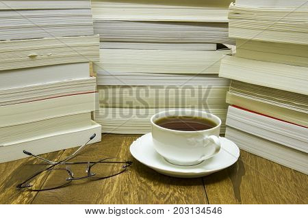 Reading Glasses With Cup Of Tea And Books