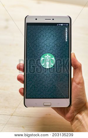 KALININGRAD, RUSSIA - CIRCA SEPTEMBER, 2017: Starbucks app opening screen on Asus Zenfone 3 Ultra smartphone. Starbucks Corporation is an American coffee company and coffeehouse chain.