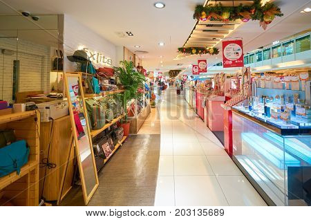 HONG KONG - DECEMBER 26, 2015:  goods on display at a store at a shopping center in Hong Kong. Shopping is a widely popular social activity in Hong Kong.