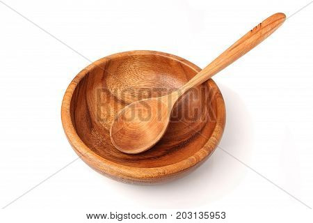 Wooden utensils isolated on white background.Bowl and spoon.