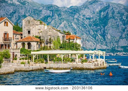 Montenegro - June 04/2017. Tourists Sailed On The Yacht Past The City Of Perast In The Boka Bay Of K