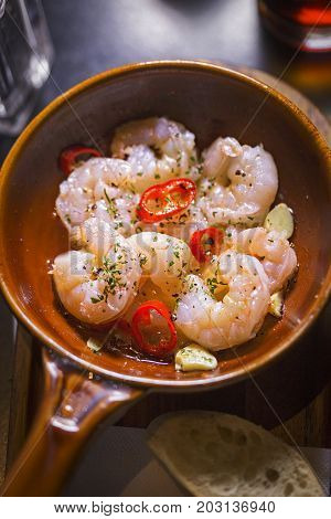 Gambas al ajillo. Cooked prawns in olive oil with garlic and red hot chilli peppers
