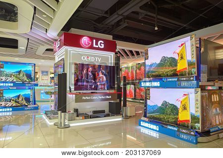 HONG KONG - NOVEMBER 02, 2015: TVs on display at electronics store in New Town Plaza. New Town Plaza is a shopping mall in the town centre of Sha Tin in Hong Kong.