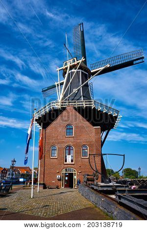 HAARLEM, NETHERLANDS - MAY 6, 2017: Windmill De Adriaan on Spaarne river. Harlem, Netherlands. The original windmill dates from 1779 and is a distinctive part of the skyline of Haarlem