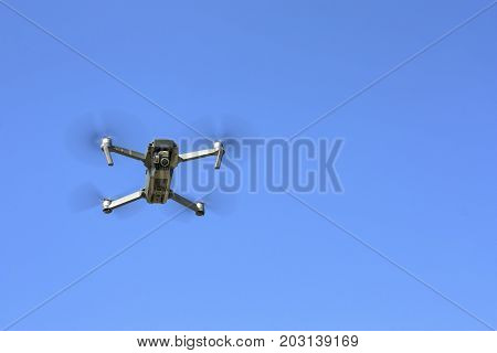 drone on left side of photo with bly sky background