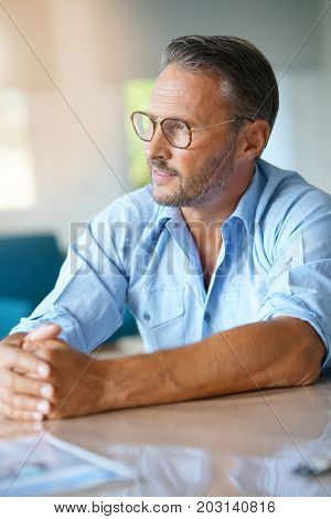 Portrait of handsome 45-year-old man with eyeglasses