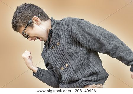 Preteen Boy Pumping Fist In Shout Of Success And Happiness