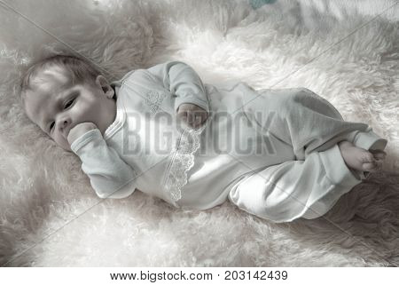 newborn happy sweet baby on furry blanket in soft colors