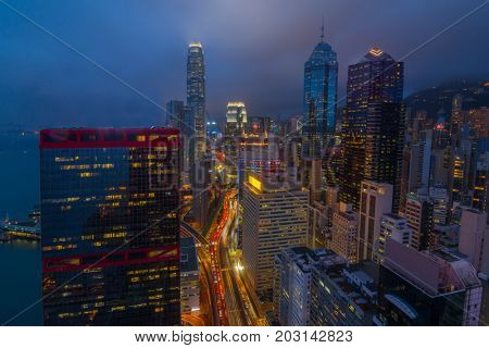 Skyscrapers and highway in business area at evening in Hong Kong, China, view from China Merchants Tower