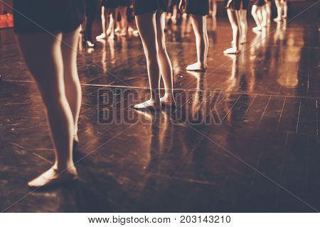 legs of young dancers ballerinas in class classical dance ballet Thailand Color Black and White Style with copyspace